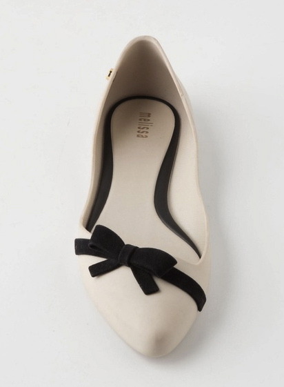Tilted Tie Rain Flats available at Anthropologie. I'm in love with these beautiful shoes. I love the slant across the toe, the lovely cream contrasted with the bow, and again the Jelly Shoe connection!